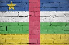 Central African Republic flag is painted onto an old brick wall stock photos