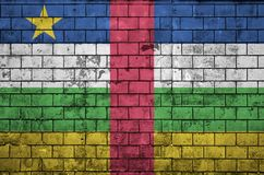 Central African Republic flag is painted onto an old brick wall stock illustration