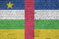Central African Republic flag is painted onto an old brick wall stock image