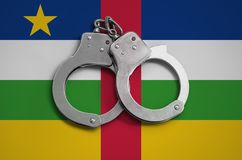 Central African Republic flag and police handcuffs. The concept of observance of the law in the country and protection from crime.  royalty free stock photo