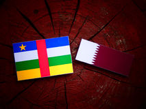 Central African Republic flag with Qatari flag on a tree stump isolated Royalty Free Stock Image