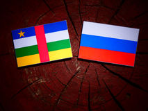 Central African Republic flag with Russian flag on a tree stump Stock Images