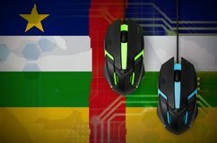 Central African Republic flag and two mice with backlight. Online cooperative games. Cyber sport team. Central African Republic flag and two modern computer mice royalty free stock image