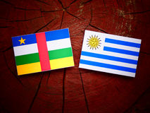 Central African Republic flag with Uruguaian flag on a tree stum Stock Images
