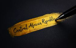Central African Republic Handwriting Text on Golden Paint Brush stock images