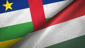 Central African Republic and Hungary two flags textile cloth, fabric texture. Central African Republic and Hungary flags together textile cloth, fabric texture royalty free stock images