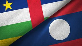 Central African Republic and Laos two flags textile cloth. Central African Republic and Laos two folded flags together stock image