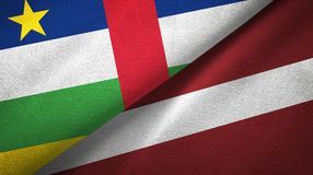 Central African Republic and Latvia two flags textile cloth, fabric texture. Central African Republic and Latvia flags together textile cloth, fabric texture royalty free stock images