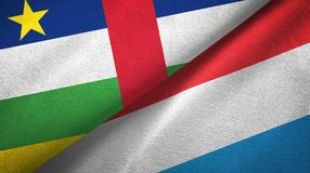 Central African Republic and Luxembourg two flags textile cloth, fabric texture. Central African Republic and Luxembourg flags together textile cloth, fabric royalty free stock photography