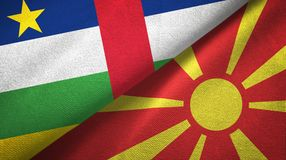 Central African Republic and Macedonia two flags textile cloth, fabric texture. Central African Republic and North Macedonia flags together textile cloth, fabric royalty free stock images