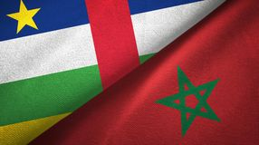 Central African Republic and Morocco two flags textile cloth, fabric texture. Central African Republic and Morocco flags together textile cloth, fabric texture stock photos