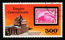 Central African Republic postage stamp shows Brandenburg Gate and German Stamp, `Graf Zepplin` Flights serie, circa 1977. MOSCOW, RUSSIA - AUGUST 29, 2017: A Royalty Free Stock Photos