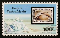 Central African Republic postage stamp shows North pole expedition, `Graf Zepplin` Flights serie, circa 1977. MOSCOW, RUSSIA - AUGUST 29, 2017: A stamp printed Royalty Free Stock Photos