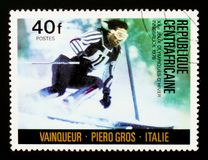 Central African republic postage stamp shows Piero Gros, Italy, Slalom, Olympic Games in Innsbruck serie, circa 1976. MOSCOW, RUSSIA - AUGUST 29, 2017: A stamp Royalty Free Stock Photos