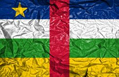 Central African Republic vintage flag on old crumpled paper background stock image