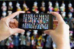 Handmade souvenirs from Central Asia,Bukhara, Uzbekistan, Silk Route. Central Asia, Ceramic colourful handmade figurines on the mobile phone at street stall in stock photo