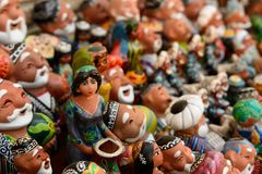 Handmade souvenirs from Central Asia,Bukhara, Uzbekistan, Silk Route. Central Asia, Ceramic colourful handmade figurines selling at street stall in Uzbekistan stock photography