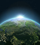 Central Asia from space during sunrise. Sunrise above Central Asia. Concept of new beginning, hope, light. 3D illustration with detailed planet surface Stock Images