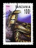 Central Asian Cobra Naja oxiana, Reptiles of Tanzania serie, circa 1993. MOSCOW, RUSSIA - JANUARY 2, 2018: A stamp printed in Tanzania shows Central Asian Cobra Royalty Free Stock Images