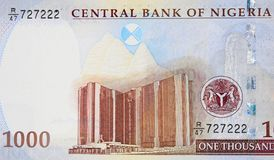 Central Bank of Nigeria corporate Head Office in Abuja on Nigerian 1000 naira (2016) banknote closeup macro, Nigerian money close. Central Bank of Nigeria stock images