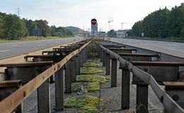 Central barrier on closed and empty highway Stock Image