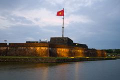 The central bastion of the ancient fortress of the Hue city, evening twilight. Vietnam. The central bastion of the ancient fortress of the Hue city in the night royalty free stock photo