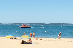 Arcachon, France. The central beach. The central beach of Arcachon, with its lifeguards and the coast guards boat at sea Stock Photos