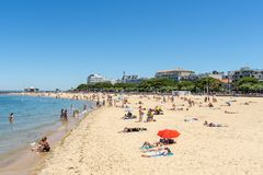 Arcachon, France, central beach, seafront and jetty. The central beach of Arcachon, with the jetty of Eyrac background from which the pleasure boats depart Stock Images