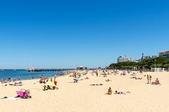 Arcachon, France, central beach, seafront and jetty. The central beach of Arcachon, with the jetty of Eyrac background from which the pleasure boats depart Stock Image