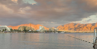 Central beach and marina of Eilat at sunset, Israel Stock Photo