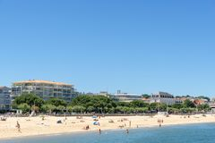 Arcachon, France. The central beach. The central beach in summer and the buildings at seafront in Arcachon, a famous french seaside resort Stock Photos