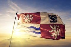 Central Bohemian Region of Czech Republic flag textile cloth fabric waving on the top sunrise mist fog. Beautiful stock illustration