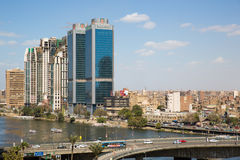 Central Cairo and the Nile river. Cairo, Egypt - March 4, 2016: The 15th May bridge, the Nile river & the Corniche Street in central Cairo Royalty Free Stock Photo