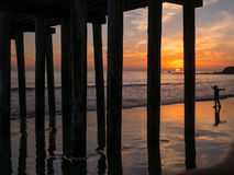 Central California Coast sunset. Sunset at the pier at Cayucos, California Royalty Free Stock Photo