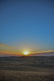 Central California Sun. Sun captured through clouds illuminating rolling grass hills Stock Photos