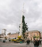 Central Christmas Tree Install in Place Kleber. STRASBOURG, FRANCE - OCT 30, 2017: People admiring Strasbourg Christmas Tree Install in central Place Kleber Stock Images