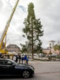 Central Christmas Tree Install in Place Kleber with taxi black u. STRASBOURG, FRANCE - OCT 30, 2017: Mercedes-Benz taxi Uber black Strasbourg Christmas Tree Stock Images