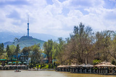 Central City Park, Almaty, Kazakhstan. View of the lake and Kok. Tobe hill Royalty Free Stock Photos