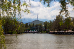 Central City Park, Almaty, Kazakhstan. View of the lake and Kok Stock Images
