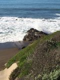 Closeup view of tide coming upon a rocky shoreline Stock Photo