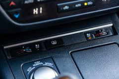 The central control console on the panel inside the car close-up buttons climate control and heated seats stock images