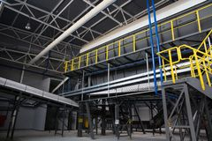 Central conveyor of the waste sorting plant. Recycling and storage of waste for further disposal stock photography