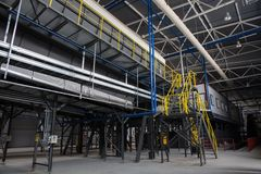 Central conveyor of the waste sorting plant. Recycling and storage of waste for further disposal stock image
