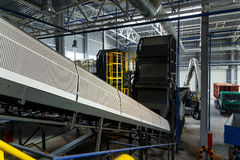 Central conveyor of the waste sorting plant. Recycling and storage of waste for further disposal Royalty Free Stock Image