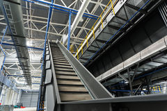 Central conveyor of the waste sorting plant. Recycling and storage of waste for further disposal Royalty Free Stock Photos