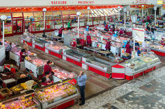 Central covered food market, meat rows, top view, Gomel, Belarus. GOMEL, BELARUS - APRIL 27, 2017: Unknown people visit meat ranks of Central covered food market royalty free stock image