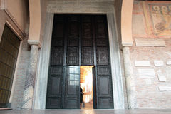 Central doorway of Saint Sabina Basilica in Rome. The central doorway of Saint Sabina Basilica on the Aventine Hill , these are the oldest carved wooden doors in Stock Photo