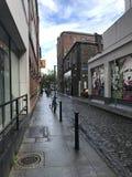 Central Dublin, Ireland - August 2, 2017: Narrow street and stre Royalty Free Stock Photos