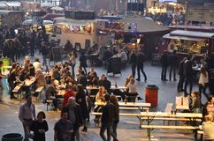 The Central-Eastern section of the Foodfestival. Amsterdam, the Netherlands - November 29, 2015: Visitors at the Kaasfondue, the Renzos and the Cart Blanche food Stock Images