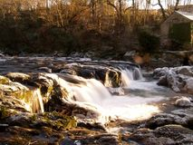 Cenarth Falls, West Wales, UK. Time-lapse shot of Cenarth falls at sunrise Stock Photography